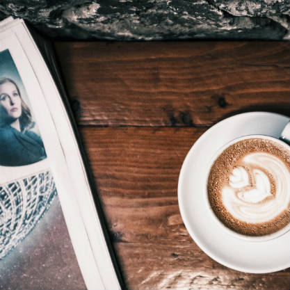 Coffee cup and newspaper