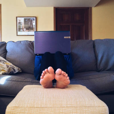 Feet on sofa with laptop